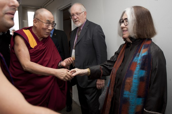 Deans Adele Santos and Robert Randolph welcoming The Dalai Lama to MIT