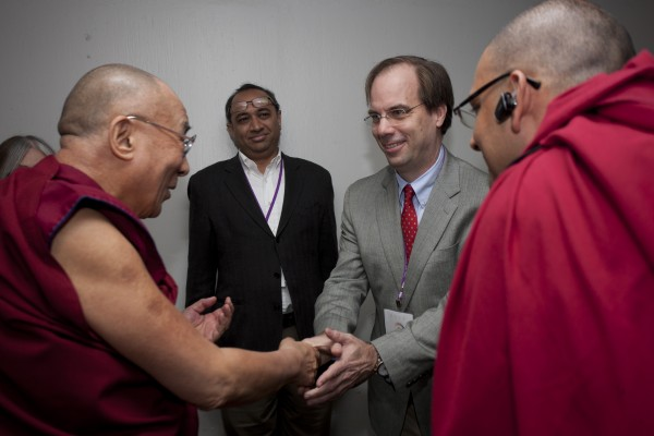 MIT Steering Committee members Sanjay Sarma and Steven Hall greeting The Dalai Lama